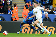 Leicester City midfielder NGolo Kante and Swansea City midfielder Jack Cork chase the ball during the Barclays Premier League match between Leicester City and Swansea City at the King Power Stadium, Leicester, England on 24 April 2016. Photo by Alan Franklin.