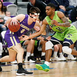 Carroll's Dane Ward drives past Providence's Jalen Shepard in the first half of Saturday's game in Helena. The Saints battled back to defeat the Argos 72-67.