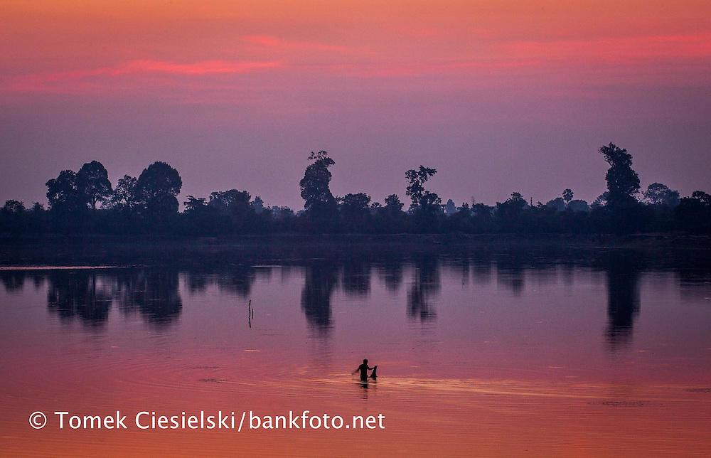 Fishermen catchink fish at sunrise