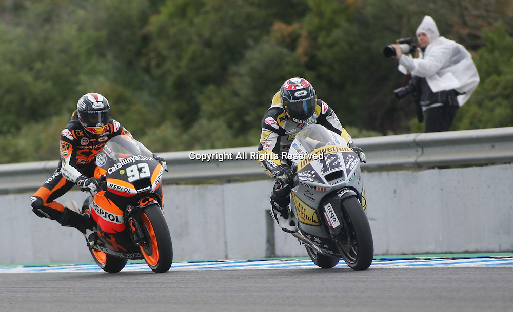 29.04.2012. Jerez, Spain. Frand Prix of Spain BWIN Race 2. Picture shows Marc Marquez (ESP) riding Suter and Thomas Luthi (SWI) riding Suter