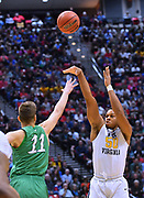 SAN DIEGO, CA - MARCH 18:  West Virginia Mountaineers forward Sagaba Konate (50) shoots against Marshall Thundering Herd forward Ajdin Penava (11) during a second round game of the Men's NCAA Basketball Tournament at Viejas Arena in San Diego, California.  (Photo by Sam Wasson)