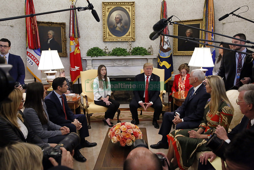 March 27, 2019 - Washington, District of Columbia, U.S. - United States President Donald J. Trump meets with Fabiana Rosales, wife of Venezuela's self-proclaimed interim president, Juan Guaido, in the Oval Office of the White House, in Washington, DC, on Wednesday, March 27, 2019  (Credit Image: © Martin H. Simon/CNP via ZUMA Wire)