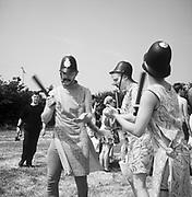 Crowd dressed up as police, Glastonbury, 1980s