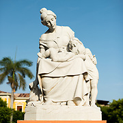 "A statue devoted to motherhood in Parque Central. The inscription reads ""Mother of all devotion and love."" Parque Central is the main square and the historic heart of Granada, Nicaragua."