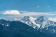 Snow-capped peaks of the Mission Mountains in spring.