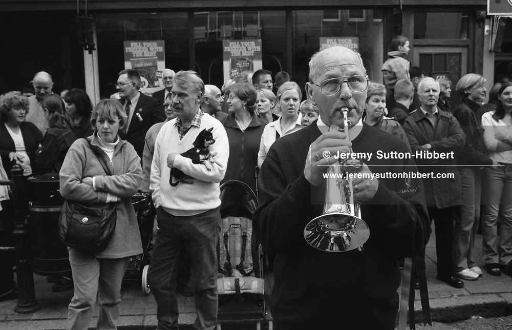 """A trumpeter in the public, waiting for the """"ride-out"""" of horses, and their riders, to begin during Hawick Common Riding week.. Scotland..PIC©JEREMY SUTTON-HIBBERT 2000.."""