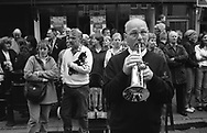 "A trumpeter in the public, waiting for the ""ride-out"" of horses, and their riders, to begin during Hawick Common Riding week.. Scotland..PIC©JEREMY SUTTON-HIBBERT 2000.."