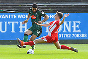 Sean McConville (11) of Accrington Stanley slides in to tackle Jake Jervis (14) of Plymouth Argyle during the EFL Sky Bet League 2 match between Plymouth Argyle and Accrington Stanley at Home Park, Plymouth, England on 1 April 2017. Photo by Graham Hunt.