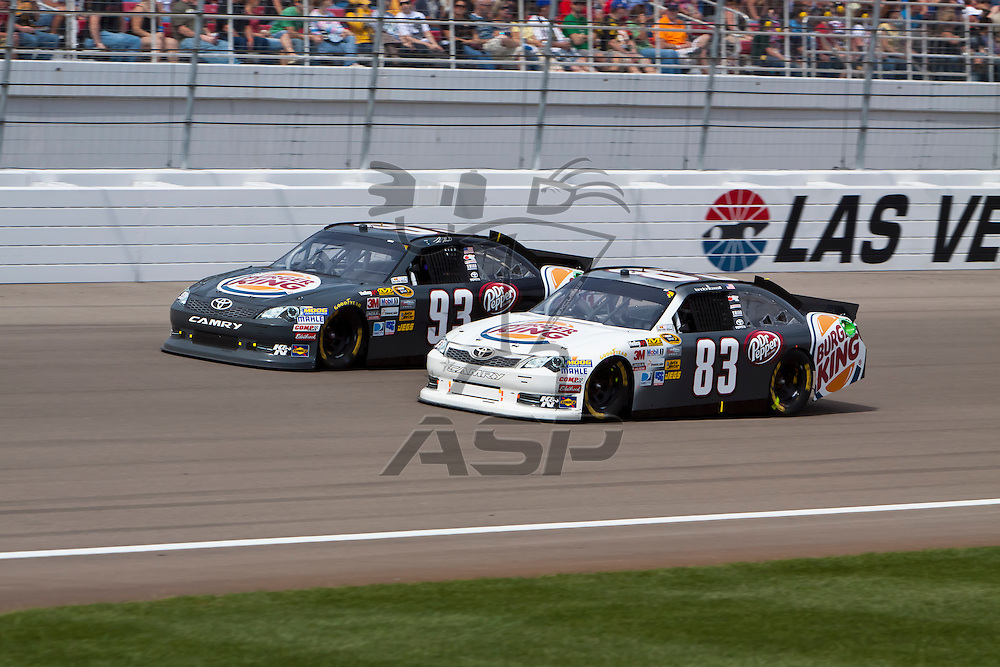 LAS VEGAS, NV - MAR 11, 2012:  Travis Kavapil (93) and Landon Cassill (83) battle for position during the Kobalt Tools 400 race at the Las Vegas Motor Speedway in Las Vegas, NV.