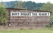 """""""Don't forget the memories"""" sign on a building in Mendocino County, California."""