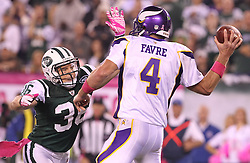 Oct 11, 2010; East Rutherford, NJ, USA; New York Jets safety Jim Leonhard (36) pressures Minnesota Vikings quarterback Brett Favre (4) during the first half at the New Meadowlands Stadium.