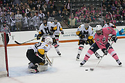 Pittsford forward John Mozrall prepares to shoot on McQuaid goalie Conner Pulli during the annual Pink the Rink game at RIT's Gene Polisseni Center in Henrietta on Saturday, February 4, 2017.