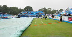 LIVERPOOL, ENGLAND - Thursday, June 16, 2011: The rain covers come on during day one of the Liverpool International Tennis Tournament at Calderstones Park. (Pic by David Rawcliffe/Propaganda)