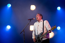 © Licensed to London News Pictures . 09/08/2015 . Siddington , UK . ANDY MCCLUSKEY of OMD ( Orchestral Manoeuvres in the Dark ) performing . The Rewind Festival of 1980s music , fashion and culture at Capesthorne Hall in Macclesfield . Photo credit: Joel Goodman/LNP