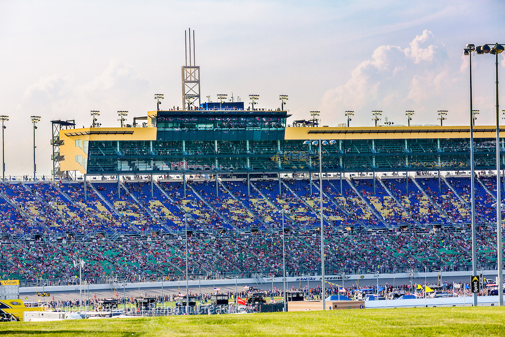 crowd in grandstand at Kansas Speedway 1.5 mile tri-oval suitable for all types of racing.