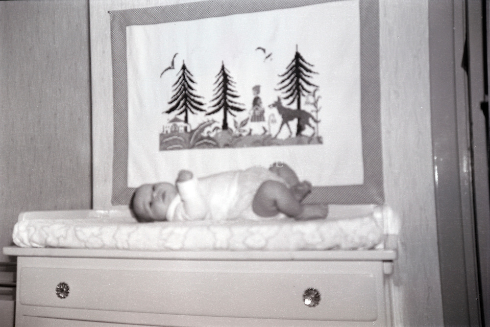 snapshot with baby on commode 1960s