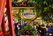 Visitors to Macy's Herald Square enjoy Carnival, the 43rd Annual Macy's Flower Show, Sunday, March 26, 2017, in New York. The show runs through Sunday, April 9 and is free to the public.  (Photo by Diane Bondareff/AP Images for Macy's Inc.)