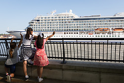 © Licensed to London News Pictures. 06/05/2018. London, UK. Children watch as 228-metre-long cruise ship Viking Sun is seen making her way down the River Thames at the end of a 3 day visit to Greenwich in south east London. The visit by Viking Sun, which has a capacity of 930 passengers, marks the beginning of London's cruise ship season. For passengers on board, London was the end of a 141 night round the world cruise which started in Miami last December. Photo credit: Vickie Flores/LNP
