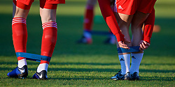 BANGOR, WALES - Saturday, November 17, 2018: Wales players apply stretch bands during the pre-match warm-up before the UEFA Under-19 Championship 2019 Qualifying Group 4 match between Sweden and Wales at the Nantporth Stadium. (Pic by Paul Greenwood/Propaganda)