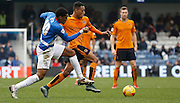 Queens Park Rangers midfielder Leroy Fer tries to take the ball from Wolverhampton Wanderers midfielder Rajiv Van La Parra during the Sky Bet Championship match between Queens Park Rangers and Wolverhampton Wanderers at the Loftus Road Stadium, London, England on 23 January 2016. Photo by Andy Walter.