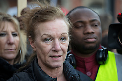 © Licensed to London News Pictures . 11/01/2014 . Tottenham , London , UK . CAROLE DUGGAN .  Campaigners hold a vigil in memory of Mark Duggan outside Tottenham Police Station this afternoon (11th January 2014) . A jury found Duggan was lawfully killed by police in August 2011 . Duggan's shooting and a protest at the same location in August 2011 sparked riots and several days of looting across London and England . Photo credit : Joel Goodman/LNP