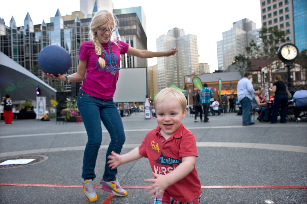 Preston Geitner dances with Kellee Maize (left) at the Downtown Neighborhood Block Party in Market Square. Maize works for Nakturnal Market Company and was one of organizers for the annual event.