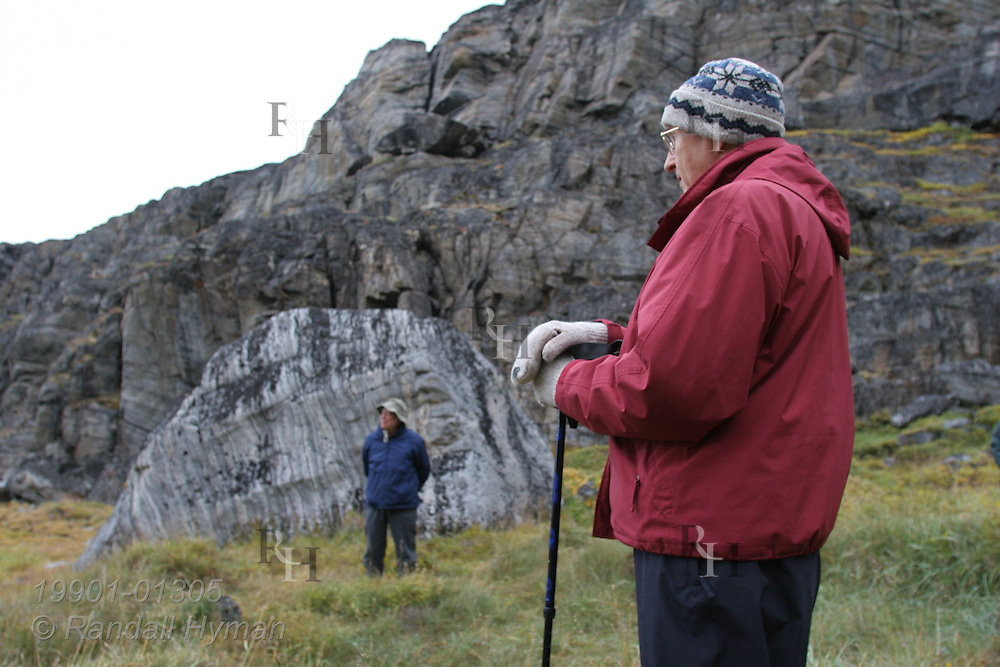 Passengers from expedition cruise ship Clipper Adventurer explore Qilakitsoq archaeological site where eight well-preserved 15th-century Inuit mummies were rediscovered in 1972; Uummannaq, Greenland