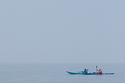 Evening Kayakers enjoy the peaceful calm of a misty Portobello evening.<br /> © Jon Davey/ EEm