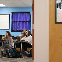 Thomas Wells | BUY at PHOTOS.DJOURNAL.COM<br /> Madelyn Von Strahm, from left, Katelyn Williams and Jillian Mitchell join their classmates as they use their chromebooks to answer trvia questions about the cold war during their history class at Tupelo High School,