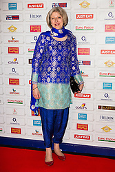 © Licensed to London News Pictures. 02/12/2014. London, UK. Home secretary, Theresa May wearing shalwar kameez arrives at the British Curry Awards at Battersea Evolution on 1st December 2014. Photo credit : Vickie Flores/LNP