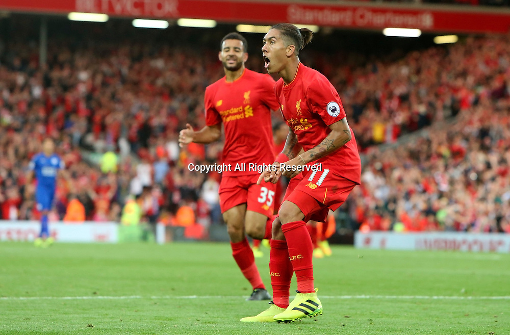 10.09.2016. Anfield, Liverpool, England. Premier League Football. Liverpool versus Leicester.Roberto Firmino of Liverpool celebrates his second goal which gave Liverpool a 4-1 lead.