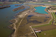 Nederland, Limburg, gemeente Stein, 07-03-2010; Meers, werkzaamheden in het kader van het project Grensmaas. Links de Maas met verbreedde stroomgeul, de gegraven plas gaat dienen als gronddepot.  .Grensmaas project is een samenspel van rivierbeveiliging door stroomgeulverbreding en oeververlaging, natuurontwikkeling en ontgrinding..Meers, work under the project Meuse. Left the river with widened stream channel, the dug lake will serve as the soil depot..Grensmaas (Border Meuse) project is a combination of security by stream channel widening and bank reduction, habitat developemnet and 'de-gravelisation').luchtfoto (toeslag), aerial photo (additional fee required).foto/photo Siebe Swart