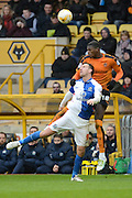 Wolverhampton Wanderers defender Dominic Iorfa beats Blackburn Rovers striker Chris Brown to a header during the Sky Bet Championship match between Wolverhampton Wanderers and Blackburn Rovers at Molineux, Wolverhampton, England on 9 April 2016. Photo by Alan Franklin.