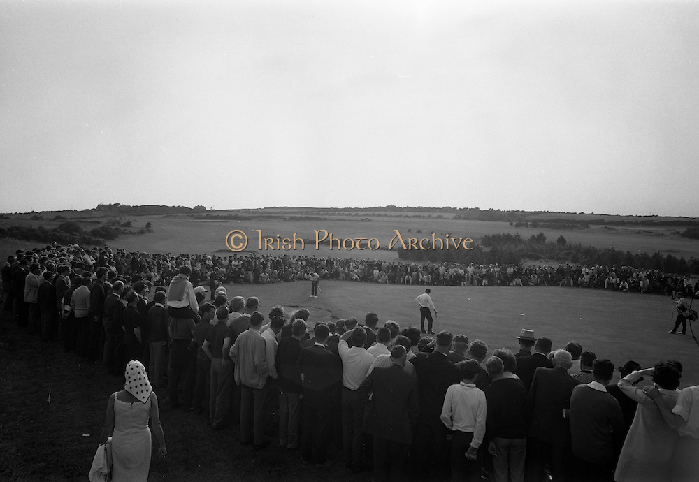 20/08/1967<br /> 08/20/1967<br /> 20 August 1967<br /> Irish Dunlop £1,000 Tournament at Tramore Golf Club, Co. Waterford. Norman Drew (left) of Bradshaws Brae and Christy Greene of Miltown coming off the 18th green at the close of the competition. Image shows Hugh Boyle on left, putting on the 18th green while Christy O'Connor watches.