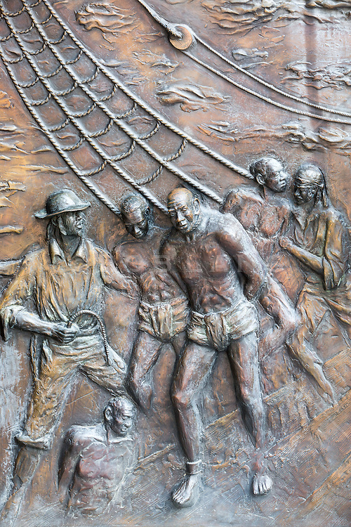 detail of an African American memorial to slaves in The South