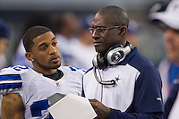 06 November 2011: Secondary coach Brett Maxie of the Dallas Cowboys speaks to (32) Orlando Scandrick while playing against the Seattle Seahawks during the second half of the Cowboys 23-13 victory over the Seahawks at Cowboy Stadium in Arlington, TX.