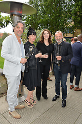 Left to right, GIORGIO LOCATELLI, PLAXY LOCATELLI, NIGELLA LAWSON and GRAHAM NORTON at an Evening at The River Cafe in aid of the NSPCC held at The River Cafe, Thames Wharf, Rainville Road, London on 19th June 2016