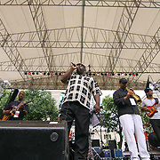 Philip Joseph, CENTER, a native of Wilmington Delaware performs with Aniya Jazz band in front of a large crowd on the last day of the 26th annual duPont Clifford Brown Jazz Festival Saturday, June 21, 2014, at Rodney Square Park in Wilmington, DEL.    <br /> <br /> &ldquo;The Clifford Brown Jazz Festival is a staple of Wilmington&rsquo;s performing arts culture,&rdquo; said Mayor Dennis P. Williams. &ldquo;The City is excited to celebrate the 26th anniversary and I hope the community gets involved and enjoys all of the many activities the festival has to offer.&rdquo;<br /> <br /> The Clifford Brown Jazz festival is the largest FREE out door music event on the east coast of the United States.