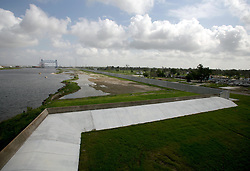 29 August 2006. New Orleans, Louisiana. Lower 9th ward. One year later, on the anniversary of devastating hurricane Katrina, the repaired and in theory stronger levee flood wall along the industrial canal that last year breached, needlessly killing hundreds of innocent civilians in the worst engineering disaster in US history.<br /> Photo Credit©; Charlie Varley/varleypix.com