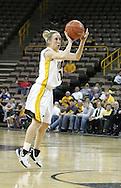 08 February 2007: Iowa guard Kristi Smith (11) attempts a three pointer in Iowa's 66-49 win over Michigan at Carver-Hawkeye Arena in Iowa City, Iowa on February 8, 2007.