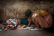 A mother comforts her child at the Sadarghat ferry terminal.