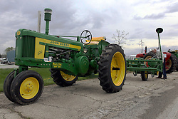 04 May 2013:   Arranged to coincide and be a part of the Red Corridor Route 66 festival, the village of Lexington hosts an antique tractor show.  Roger Whaley is the chairman of the organizing committee.  1957 John Deere model 520 with planter attached.