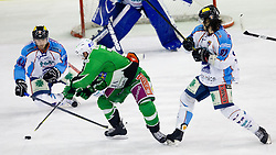 John Hughes (HDD Tilia Olimpija, #72) vs Juray Durc (SAPA Fehervar AV19, #44) and Ladislav Sikorcin (SAPA Fehervar AV19, #81) during ice-hockey match between HDD Tilia Olimpija and SAPA Fehervar AV19 at sixth match in Quarterfinal  of EBEL league, on March 1, 2012 at Hala Tivoli, Ljubljana, Slovenia. HDD Tilia Olimpija won 4:3. (Photo By Matic Klansek Velej / Sportida)