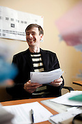 Investigative reporter Roman Shleynov at the office of Novaya Gazeta newspaper in Moscow, standing in front of colleagues killed at work. Novaya Gazeta is one of the few remaining independent media outlets in Russia that dare to challenge the Kremlin, but it has paid a heavy price for its courage. Anna Politkovskaya, the newspaper's most prominent journalist, was gunned down in her apartment block in Moscow in 2006.   ..Picture by Justin Jin.