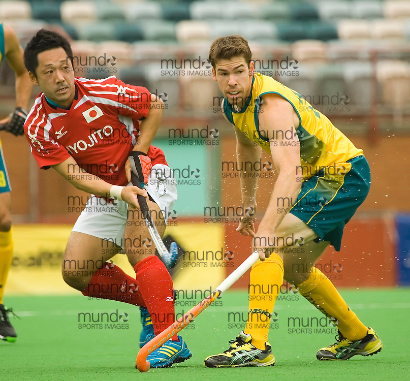 (Canberra, Australia---01 April 2012) Kazuyki Ozawa of Japan and Graeme Begbie of the Australia Kookaburra national field hockey team playing in the third of a three game field hockey test match series between Australia and Japan men's field hockey teams. Australia won the game 7-1 and the series 3-0. 2012 Copyright Photograph Sean Burges / Mundo Sport Images.