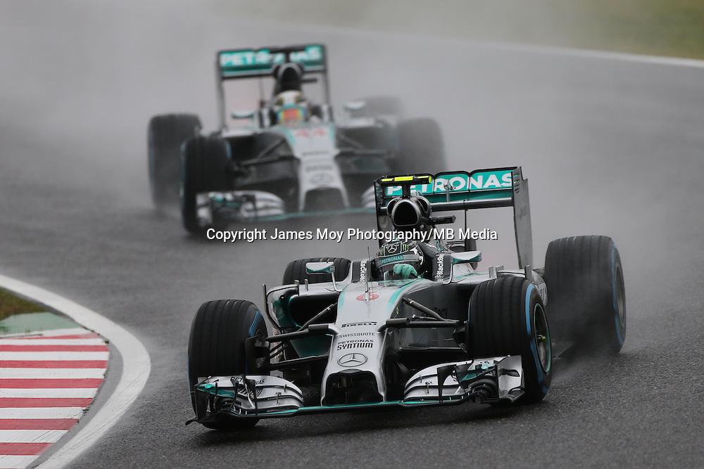 Nico Rosberg (GER) Mercedes AMG F1 W05 leads team mate Lewis Hamilton (GBR) Mercedes AMG F1 W05.<br /> Japanese Grand Prix, Sunday 5th October 2014. Suzuka, Japan.