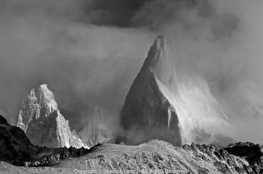 Patagonia spires rise above the cloudscape and wind blown land.