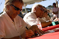 MONTEREY, CA - AUGUST 18:  Racing legends Derek Bell (L)  and Ove Anderson (R) were among other racers who signing autographs at the Monterey Historic Automobile Races at the Mazda Raceway Laguna Seca on August 18, 2007 in Monterey, California.  (Photo by David Paul Morris)