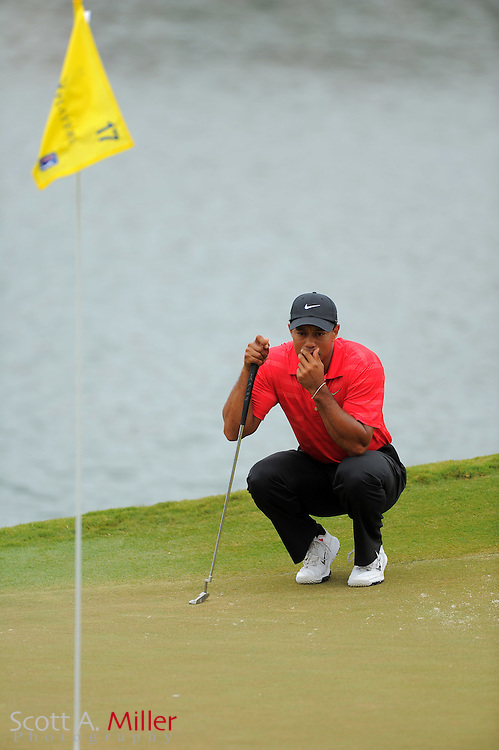 Tiger Woods lines up his putt on the 17th hole during the final round of the Players Championship at the TPC Sawgrass on May 13, 2012 in Ponte Vedra, Fla. ..©2012 Scott A. Miller..