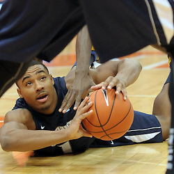 Monmouth Hawks guard DION NESMITH (1) looks to pass the ball after diving on it in the Syracuse Orange end of the court during the second half at the Carrier Dome in Syracuse, New York. No. 4 Syracuse defeated Monmouth 108-56 in front of a crowd of 21,760.